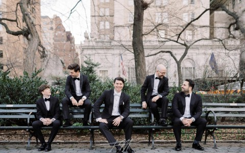 groomsmen sitting outside