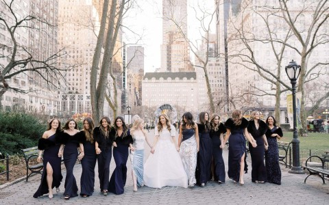 bride posing with bridesmaids