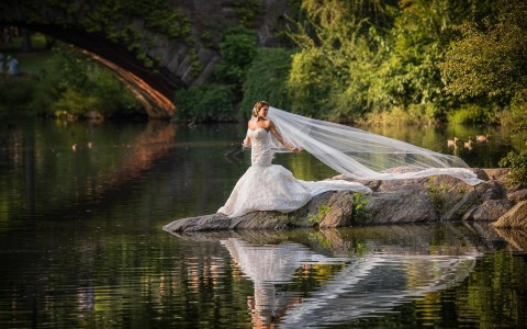 bride standing by water
