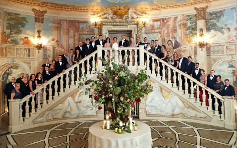 Wedding party posing in stair case