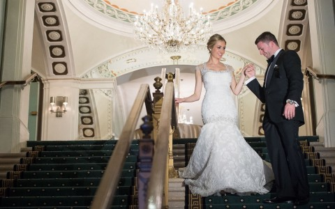 bride and groom walking down stairs