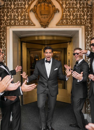 groom walking down in middle of groomsmen