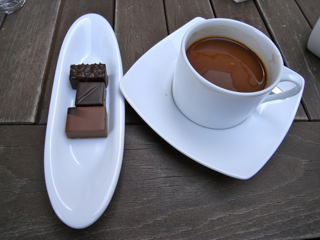 Coffee and Chocolates Served in White Ceramic Mug and Plates