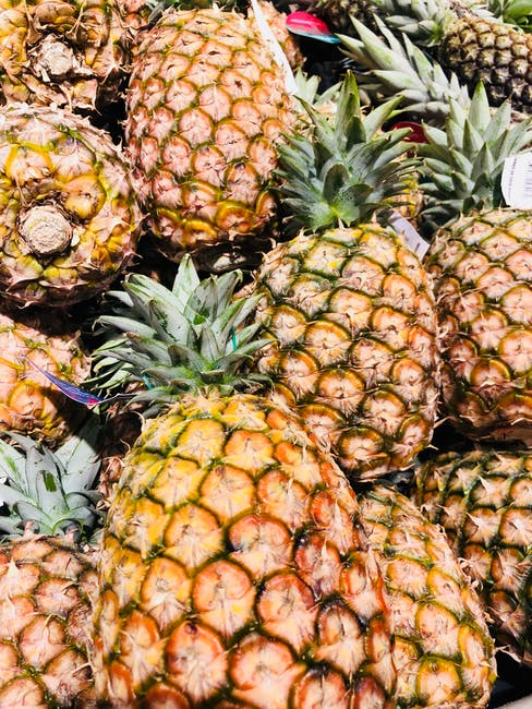 group of pineapples at produce market