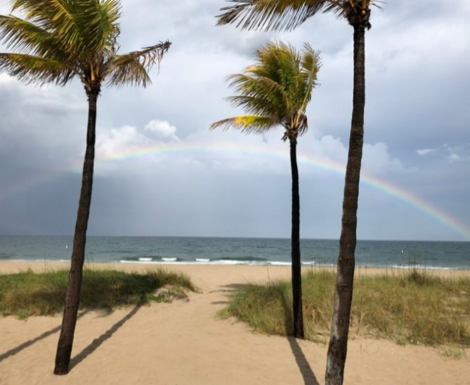 View of beach and rainbow