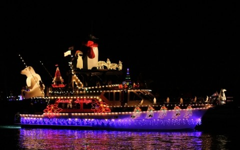 boat with christmas lights at night
