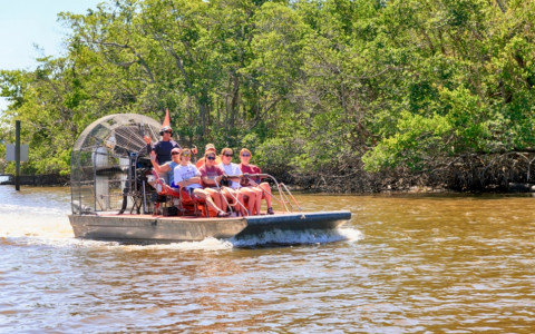 airboat with tourists in everglades