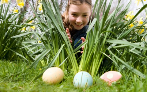 child looking for easter eggs