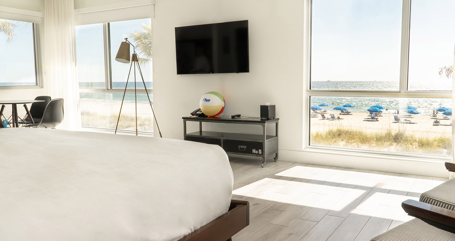 beachfront room with beach ball under tv