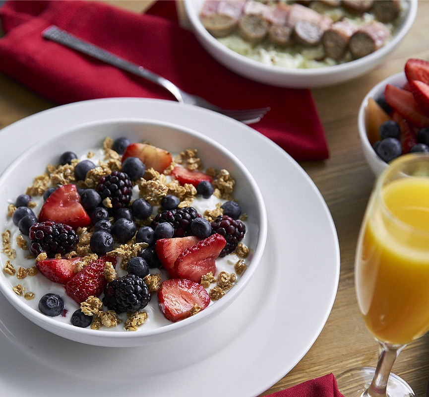 yogurt with granola and berries with a mimosa on the side
