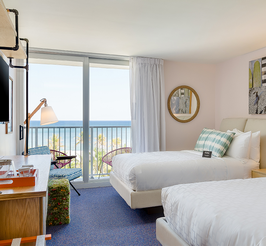 bedroom with two beds and ocean view