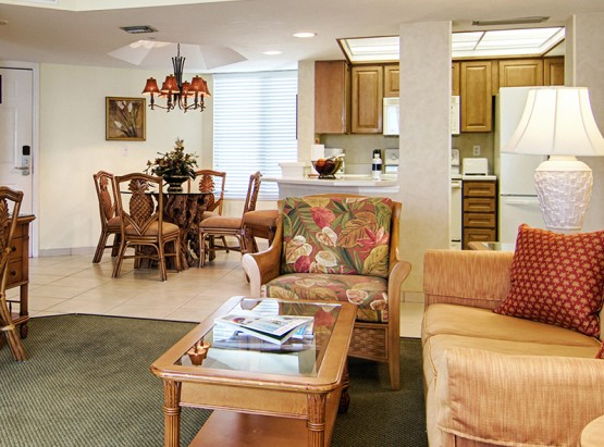 Living & dining room areas next to full kitchen