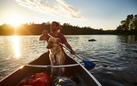 canoe tour with a dog and a man