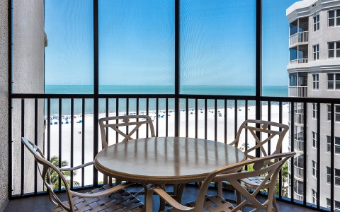 suite balcony overlooking the beach with a gulf view