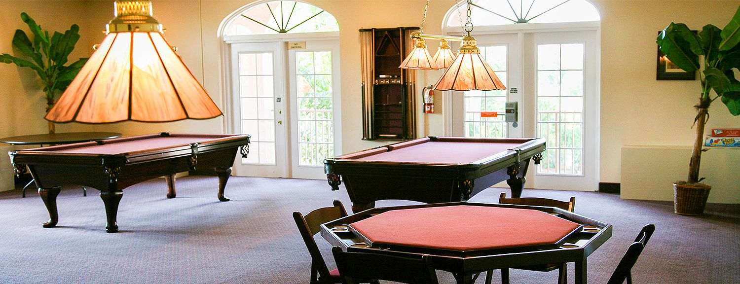 Room with card playing & billiard tables