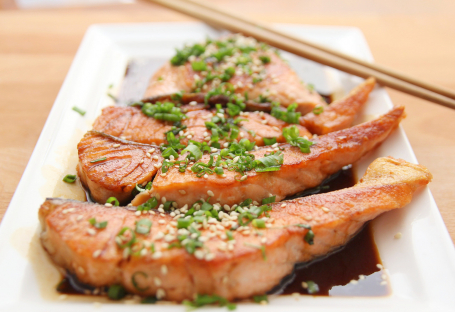 Raw fish on dish with soy sauce & chopsticks