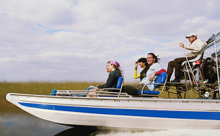 Group of people enjoying airboat ride through everglades