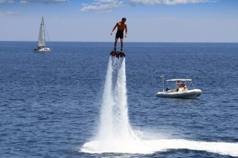 man using a water jetpack