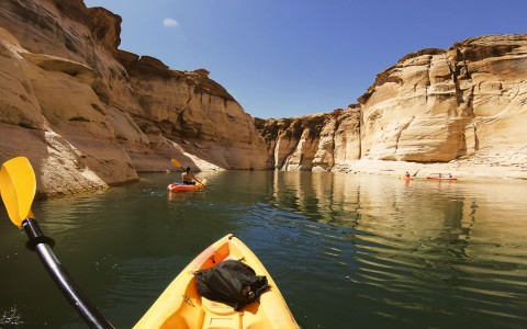person kayaking in a canyon