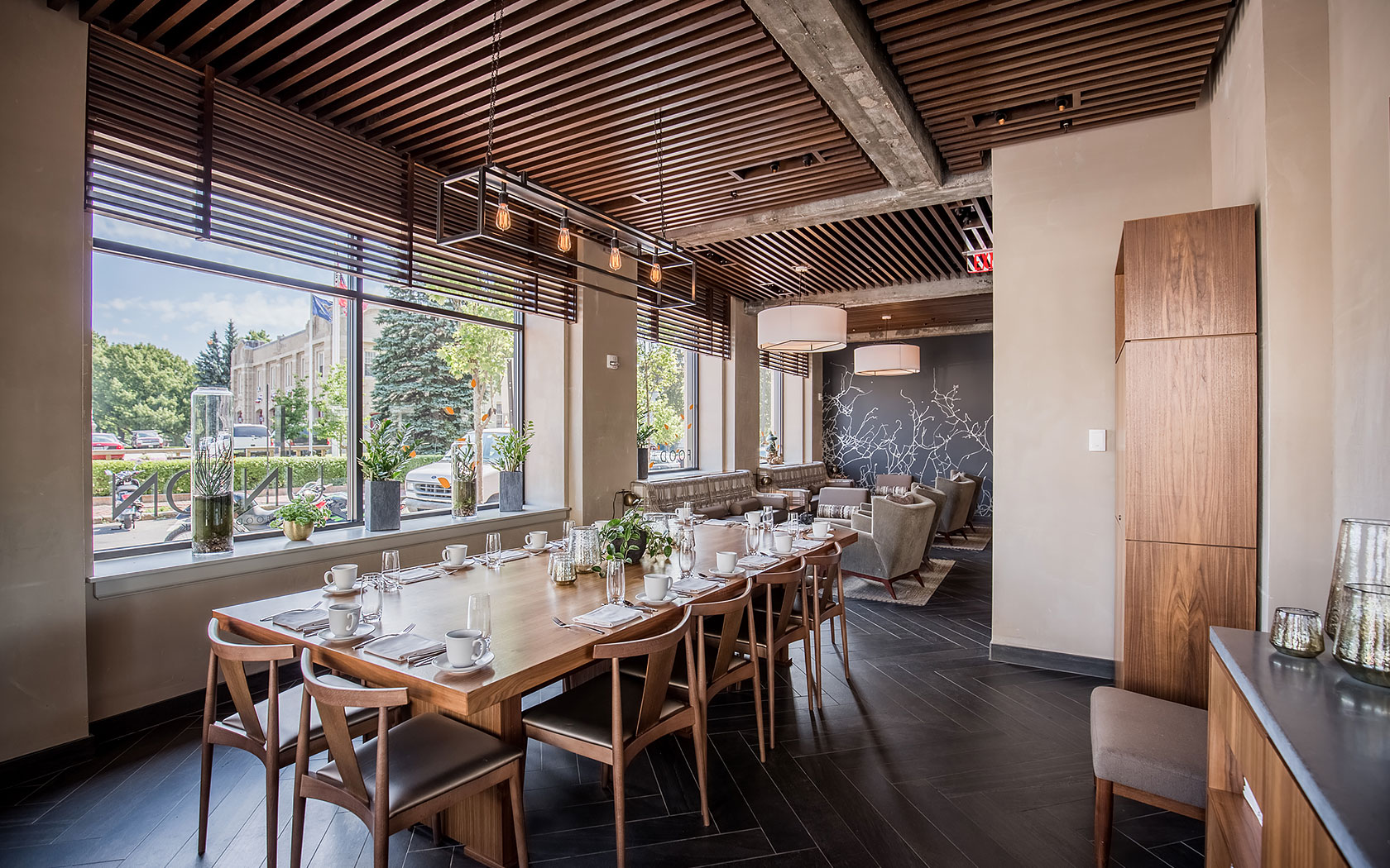Union Restaurant Dining Area With Wooden Tables And Large Window Panels