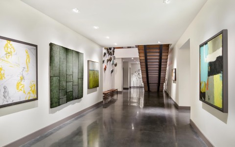 Hallway with artworks hung on walls