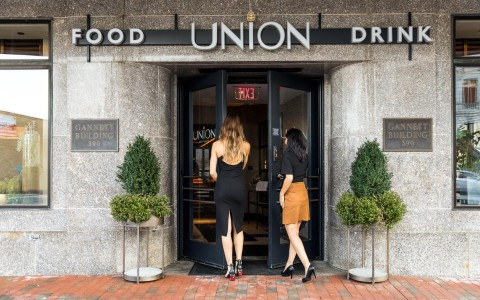Two women walking into Union restaurant
