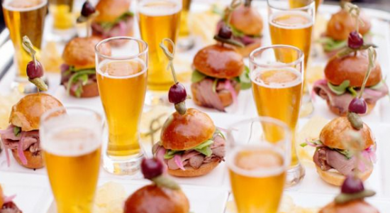 beer and sandwiches on table