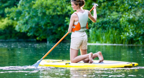 Woman paddleboarding in lake