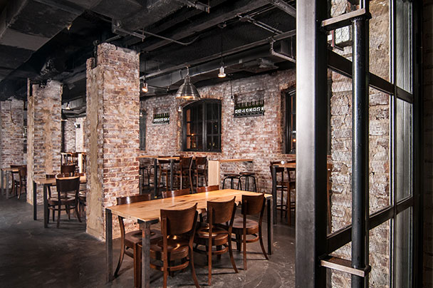Edgars interior brick walls and brown leather chairs