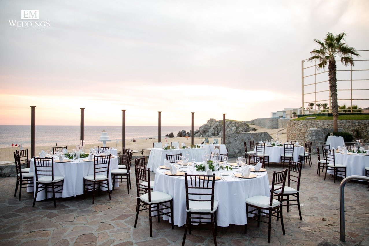 tables on terrace overlooking ocean
