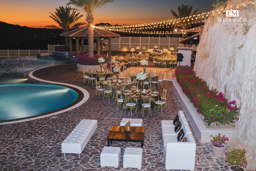 aerial view of wedding reception area near pool during sunset