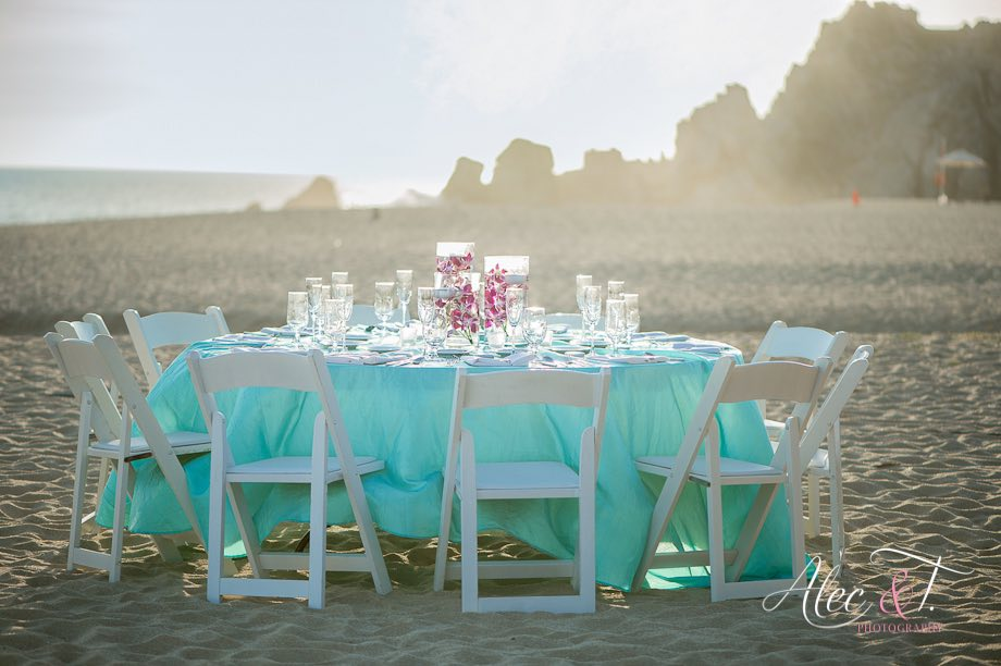 single table on beach with turquoise linen