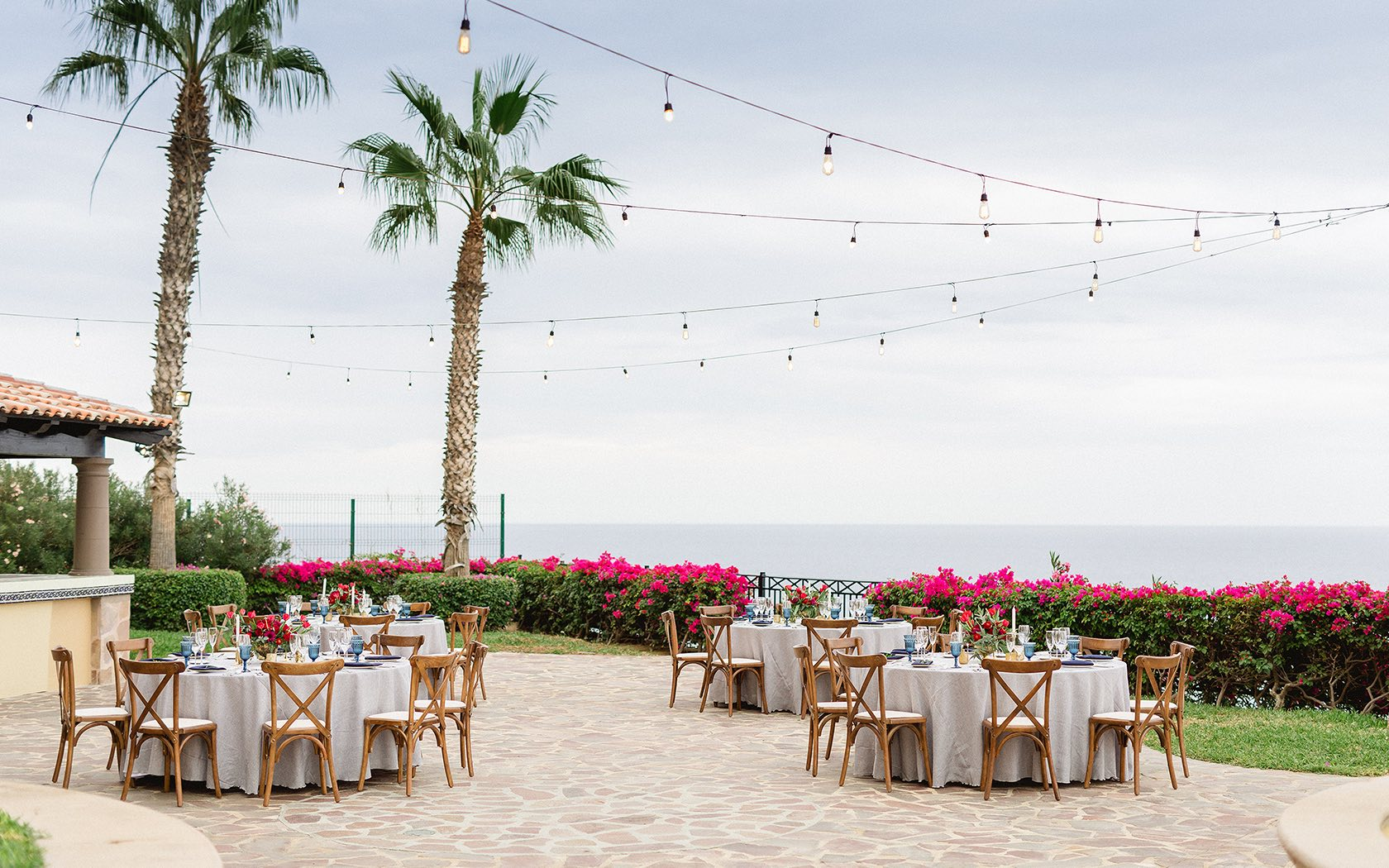 outside venue with string lights and ocean view