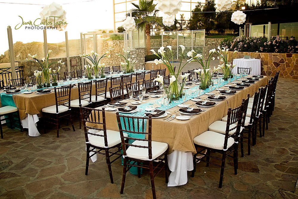 tables on terrace with flowers and brown linen
