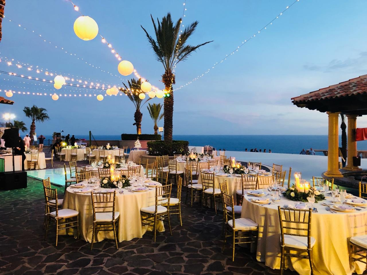 night view of wedding reception that overlooks ocean