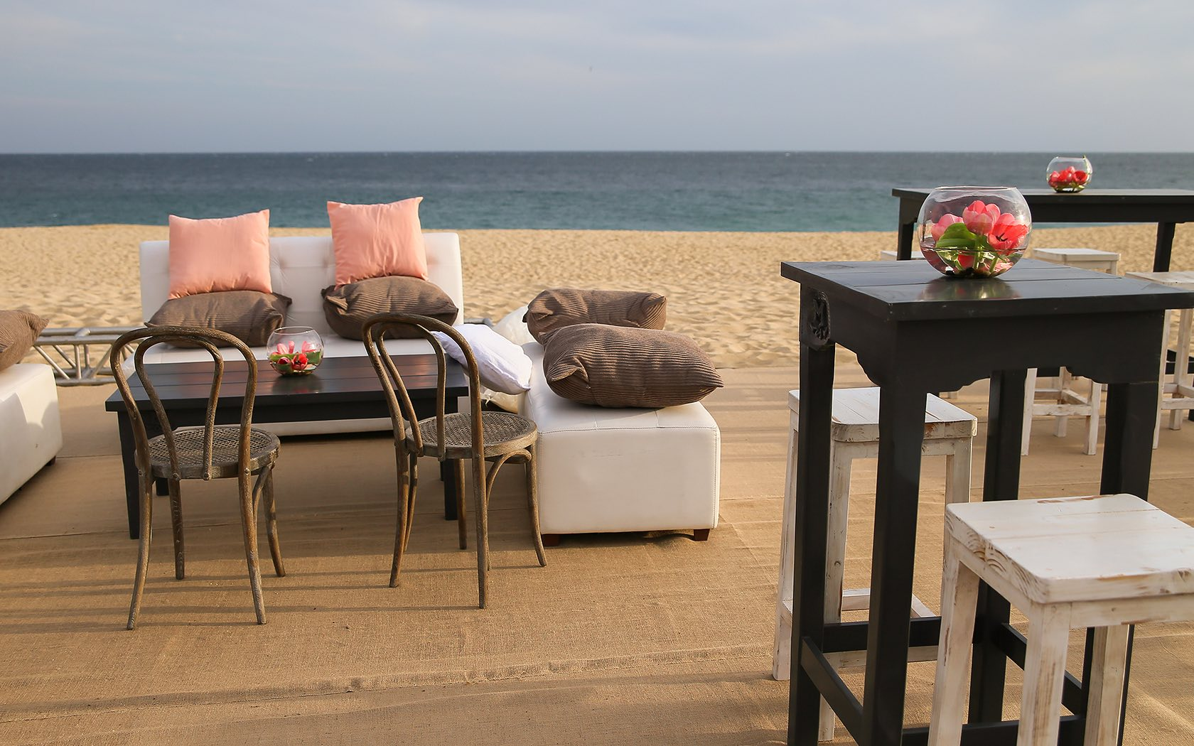 tables, couches, and chairs on beach