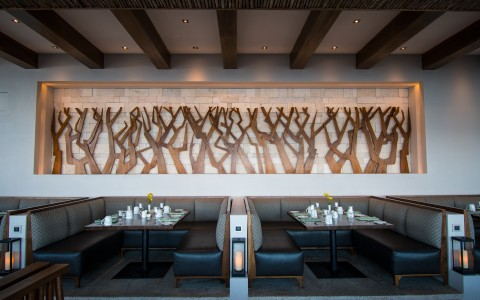 carved wood wall art at restaurant