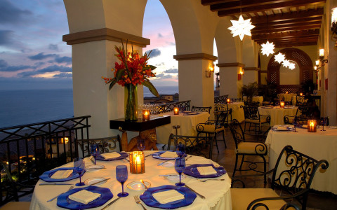 outside patio seating at night overlooking ocean