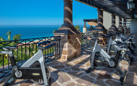 cycle bikes on patio overlooking ocean