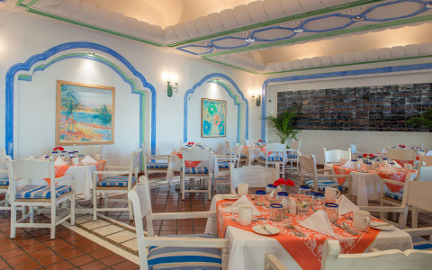 restaurant with tables and blue and orange accents