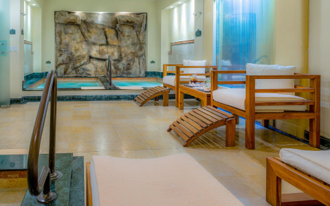 jacuzzis with small wooden benches in seating area