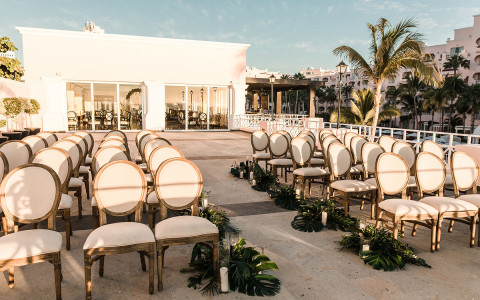 white chairs set up outside for ceremony