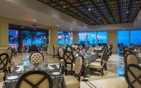 restaurant seating with black details and ocean views