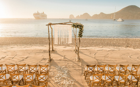 wedding ceremony set up by ocean
