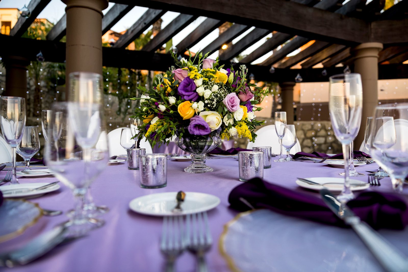purple table with floral arrangement on top3