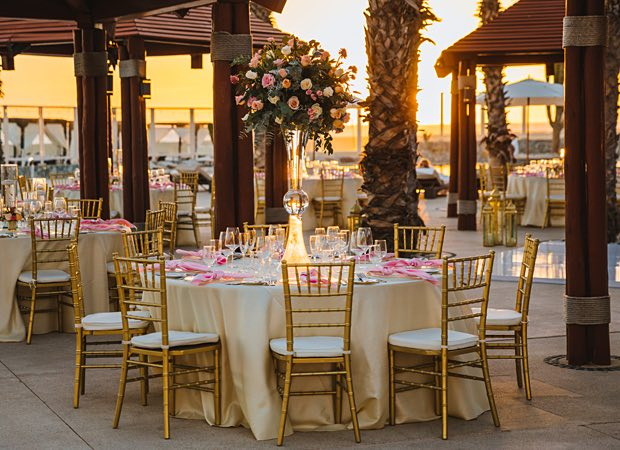 gold decor with table and flower arrangement