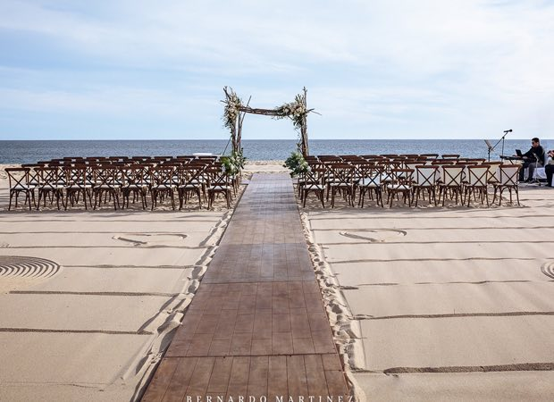 wedding ceremony set up on beach with ocean view