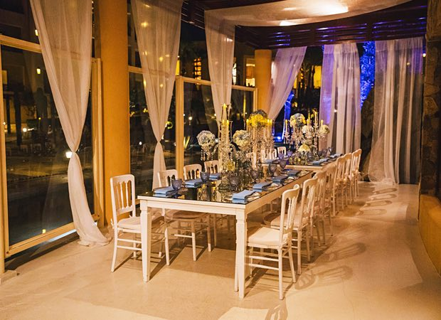 long white table in middle of the room during night
