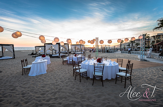 tables and string lights on beach