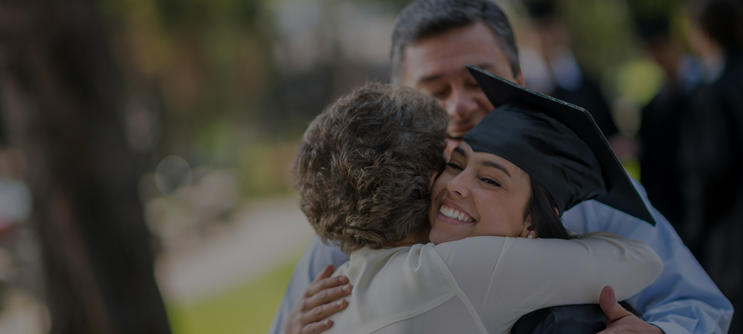 college student hugging family and smiling